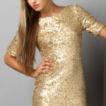 What type of jewelry can I wear with a gold sequin dress on NYE?