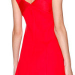 How can I accessorize a sleeveless coral color dress?