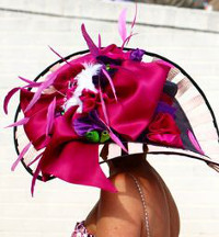 What style & color hat can I wear to the Kentucky Derby with a raspberry color dress?