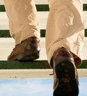 What color shoes & socks should I wear with a black polo shirt & khaki pants?