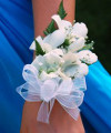 What color corsage would go with a turquoise color prom dress?