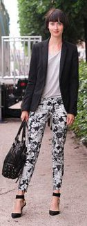 Can I wear a solid color top with black & white print pants?