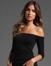 What top can I wear with a chiffon pleated skirt?